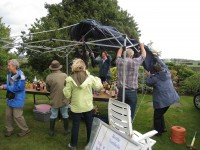 Dismantling stall at the fete in the rain!