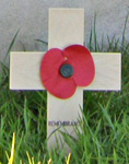 small wooden cross with a poppy