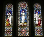 in Early English style, with 3 well seperated lights, all depicting the risen Christ (one with Mary Magdalene, one with Thomas)